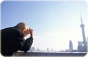image of an old man looking toward Shanghai\'s 浦东 Pudong skyline